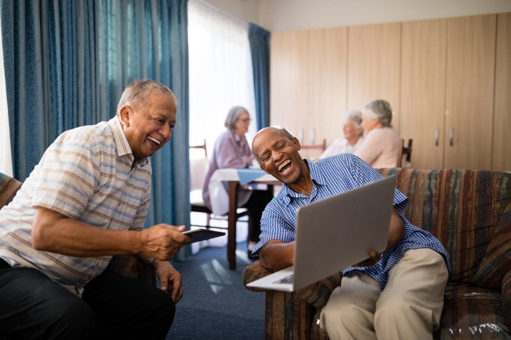 Senior Friends Looking at Laptop